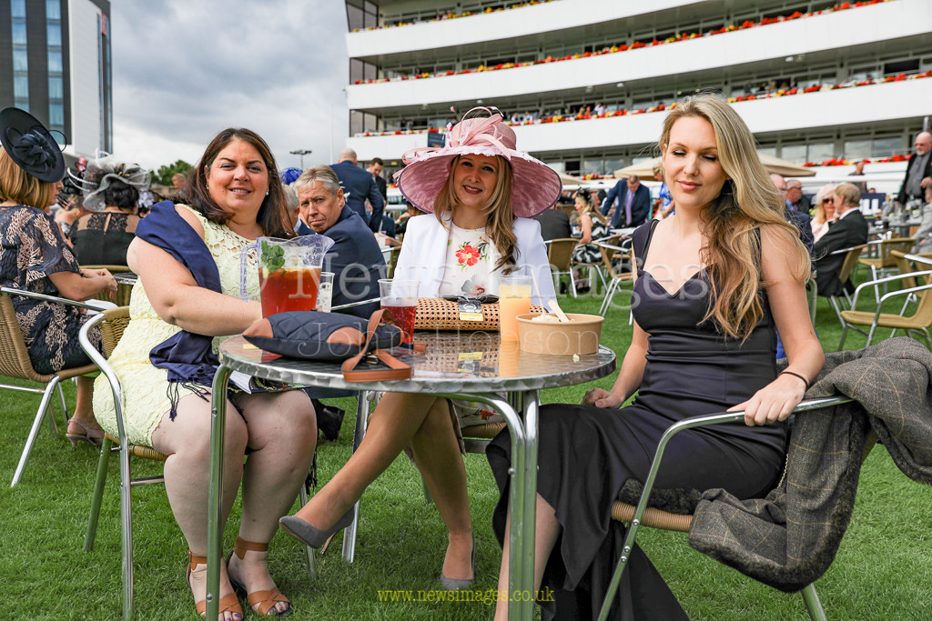15th September 2018, Doncaster Racecourse, Doncaster, England; 2018 St Leger Festival William Hill St Leger Day, Racing Preview, Racegoers enjoying a jug of Pimm's at Doncaster Racecourse on Leger Day